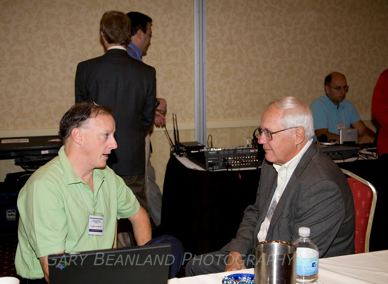 Dr. Kerr in a discussion with another attendee.
