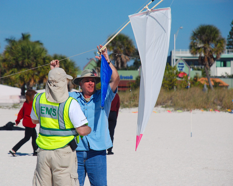 Event organizer Gary Resnick readies the specially rigged kite for the candy drop.