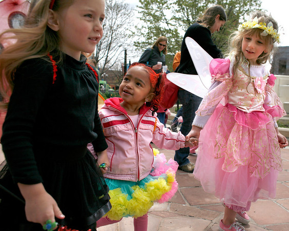 """Keira Johnson, 3 , left, Teya Ogowski, 2 1/2, and Megan Marrs, 5, hold hands during The Tulip Fairy and Elf Parade in Boulder on Friday April 30, 2010.<br /> Nicholas Duckworth  / For The Camera<br /> Watch a video of The Tulip Fairy and Elf Parade at  <a href=""""http://www.dailycamera.com"""">http://www.dailycamera.com</a>"""