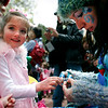 "Caroline Marter, 5, of Berthoud, CO gets a new button fairy ring from Elayna ""Lily the Blue Fairy"" Johnson at The Tulip Fairy and Elf Parade in Boulder on Friday April 30, 2010.<br /> Nicholas Duckworth  / For The Camera<br /> Watch a video of The Tulip Fairy and Elf Parade at  <a href=""http://www.dailycamera.com"">http://www.dailycamera.com</a>"