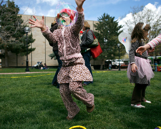 "Eleanor Malcolm, 5, chases after bubbles at The Tulip Fairy and Elf Parade in Boulder on Friday April 30, 2010.<br /> Nicholas Duckworth  / For The Camera<br /> Watch a video of The Tulip Fairy and Elf Parade at  <a href=""http://www.dailycamera.com"">http://www.dailycamera.com</a>"