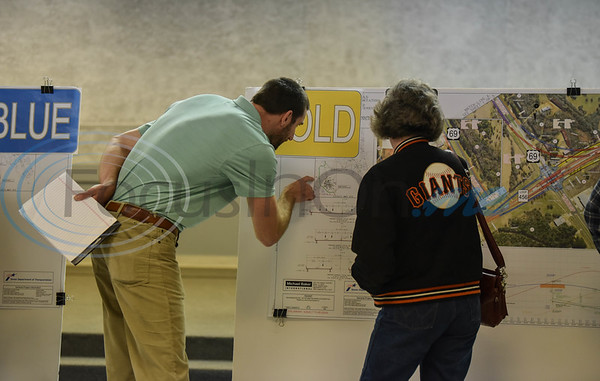 A Texas Department of Transportation employee discusses a map for the US 69 relief route during a public meeting on Thursday at the Norman Activity Center in Jacksonville. (Jessica T. Payne/Tyler Morning Telegraph)