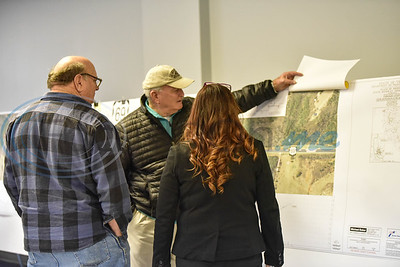 Jacksonville residents review a map of the US 69 relief route during a Texas Department of Transportation public meeting on Thursday at the Norman Activity Center. (Jessica T. Payne/Tyler Morning Telegraph)