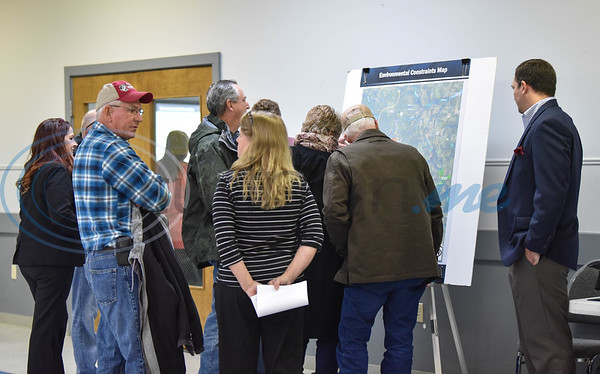Jacksonville residents gather around a map at the Norman Activity Center for a Texas Department of Transportation meeting on Thursday. The public scoping meeting was held to present and gather public input on the proposed US 69 relief route. (Jessica T. Payne/Tyler Morning Telegraph)