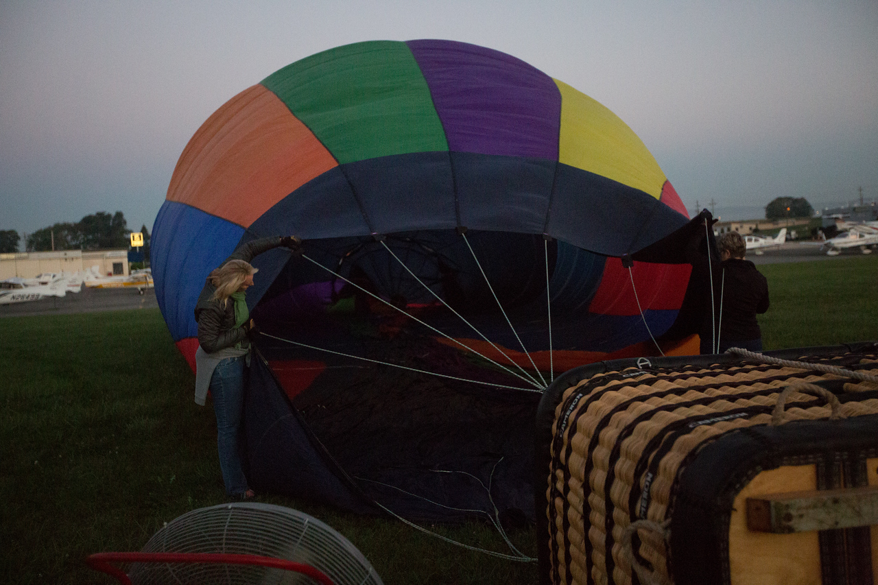 Filling the balloon with air.  It goes back a long ways.