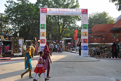 Entrance to Taj Mahotsav. Throughout the Taj Mahotsav one experiences a profusion of folk & classical music & dances of various regions, especially the Brij Bhumi, performed the way they used to be centuries ago. Besides the folk, the Mahotsav also exhibit the performance from the world renowned artistes from classical, semi-classical and popular art forms.   Taj Mahotsav (Hindi: ताज महोत्सव, Urdu: تاج مہوتسو, translation: Taj Jubilee) is an annual 10 day festival that takes place from 18th to 27th  February. The event is held at Shilpgram in Agra, India. This carnival is a vibrant platform that brings together India's finest craft and culture at one single place. It is a festive introduction to  India as a whole and Uttar Pradesh in particular, where the extensive range of  art,  craft, culture and cuisine are on display. Every year in February, tourists flock to Agra for this mega event, just a stone throw from the majestic Taj Mahal. This festival invokes the memories of old Mughal era and nawabi style prevalent in Uttar Pradesh in 18th and 19th centuries.  Taj Mahotsav Ek Utsav Pyar Ka, Celebrating Immortal Love, 18-27 February, 2010. A festival of art, craft, culture and cusuine. North, Uttar Pradesh (UP), North India.