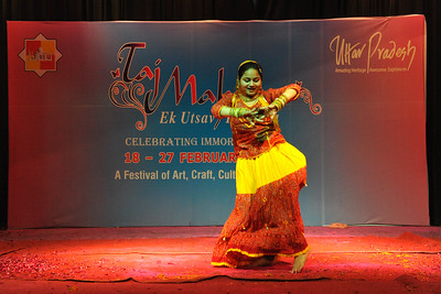Girl doing a solo dance performance at a dance & music competition held for children. Throughout the Taj Mahotsav one experiences a profusion of folk & classical music & dances of various regions, especially the Brij Bhumi, performed the way they used to be centuries ago. Besides the folk, the Mahotsav also exhibit the performance from the world renowned artistes from classical, semi-classical and popular art forms.   Taj Mahotsav (Hindi: ताज महोत्सव, Urdu: تاج مہوتسو, translation: Taj Jubilee) is an annual 10 day festival that takes place from 18th to 27th  February. The event is held at Shilpgram in Agra, India. This carnival is a vibrant platform that brings together India's finest craft and culture at one single place. It is a festive introduction to  India as a whole and Uttar Pradesh in particular, where the extensive range of  art,  craft, culture and cuisine are on display. Every year in February, tourists flock to Agra for this mega event, just a stone throw from the majestic Taj Mahal. This festival invokes the memories of old Mughal era and nawabi style prevalent in Uttar Pradesh in 18th and 19th centuries.  Taj Mahotsav Ek Utsav Pyar Ka, Celebrating Immortal Love, 18-27 February, 2010. A festival of art, craft, culture and cusuine. North, Uttar Pradesh (UP), North India.