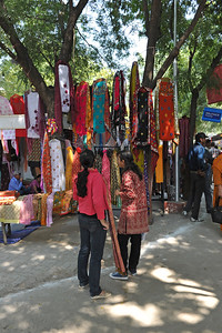 Shoppers delight. About 400 artisans from different parts of India get an opportunity to display their exquisite works of art at Taj Mahotsav. Wood/stone carvings from Tamil Nadu, Bamboo/cane work from North East India, Paper mash work from South India and Kashmir, the marble and zardozi work from Agra, wood carving from Saharanpur, brass wares from Moradabad, hand made carpets from Bhadohi, Pottery from Khurja, Chikan work from Lucknow, silk & zari work from Banaras, shawls & carpets from Kashmir/Gujarat and hand printing from Farrukhabad and Kantha stitch from West Bengal etc.  Taj Mahotsav (Hindi: ताज महोत्सव, Urdu: تاج مہوتسو, translation: Taj Jubilee) is an annual 10 day festival that takes place from 18th to 27th  February. The event is held at Shilpgram in Agra, India. This carnival is a vibrant platform that brings together India's finest craft and culture at one single place. It is a festive introduction to  India as a whole and Uttar Pradesh in particular, where the extensive range of  art,  craft, culture and cuisine are on display. Every year in February, tourists flock to Agra for this mega event, just a stone throw from the majestic Taj Mahal. This festival invokes the memories of old Mughal era and nawabi style prevalent in Uttar Pradesh in 18th and 19th centuries.  Taj Mahotsav Ek Utsav Pyar Ka, Celebrating Immortal Love, 18-27 February, 2010. A festival of art, craft, culture and cusuine. North, Uttar Pradesh (UP), North India.