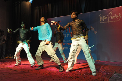 Group of boys doing a dance performance at a competition held at Taj Mahotsav. Throughout the Taj Mahotsav one experiences a profusion of folk & classical music & dances of various regions, especially the Brij Bhumi, performed the way they used to be centuries ago. Besides the folk, the Mahotsav also exhibit the performance from the world renowned artistes from classical, semi-classical and popular art forms.   Taj Mahotsav (Hindi: ताज महोत्सव, Urdu: تاج مہوتسو, translation: Taj Jubilee) is an annual 10 day festival that takes place from 18th to 27th  February. The event is held at Shilpgram in Agra, India. This carnival is a vibrant platform that brings together India's finest craft and culture at one single place. It is a festive introduction to  India as a whole and Uttar Pradesh in particular, where the extensive range of  art,  craft, culture and cuisine are on display. Every year in February, tourists flock to Agra for this mega event, just a stone throw from the majestic Taj Mahal. This festival invokes the memories of old Mughal era and nawabi style prevalent in Uttar Pradesh in 18th and 19th centuries.  Taj Mahotsav Ek Utsav Pyar Ka, Celebrating Immortal Love, 18-27 February, 2010. A festival of art, craft, culture and cusuine. North, Uttar Pradesh (UP), North India.