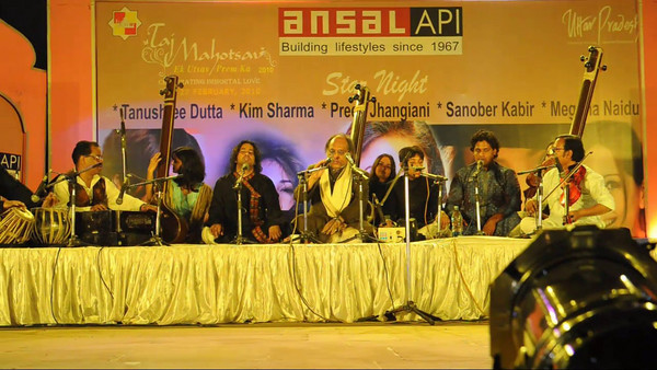 Evening musical performance at the Taj Mohotsav which is an annual ten day event held at Agra, Uttar Pradesh, India.  Throughout the Taj Mahotsav one experiences a profusion of folk & classical music & dances of various regions, especially the Brij Bhumi, performed the way they used to be centuries ago. Besides the folk, the Mahotsav also exhibit the performance from the world renowned artistes from classical, semi-classical and popular art forms.