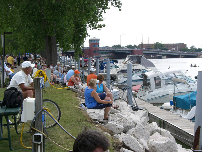 The crowds line the shore as well as the bridge as they wait for the Parade of Ships to begin.
