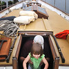 Special to the Record-Eagle/Sarah Moore Kuschell<br /> Jason Lombardi lifts his daughter Audrey Lombardi, 2, after exploring below deck on Traverse City's newest tall ship, The Perception.