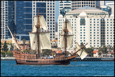 The San Salvador, a recreation of the original 100' galleon Cabrillo sailed into San Diego's harbor in 1542, seen passing in front of the Embassy Suites building downtown San Diego.