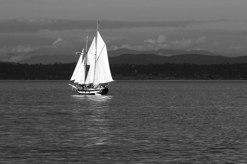 One of the tall ships from the Tall Ships Tacoma festival during a sunset cruise in Commencement Bay.  The overcast that hung overhead during the day had broken just in time for a wonderful sunset.