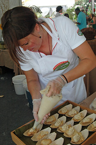 Piping the Cannellini Bean Puree onto pita chips
