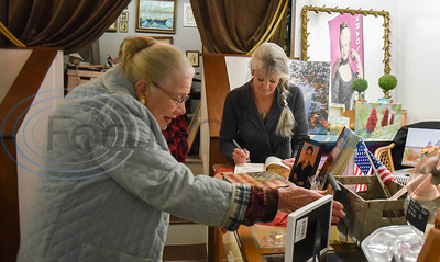 Author Tamra McAnally Bolton signs a copy of her book A Blessed Life – One World War II Seabee's Story during her book signing at Ruffles in Jacksonville on Thursday, February 6. (Jessica T. Payne/Tyler Morning Telegraph)