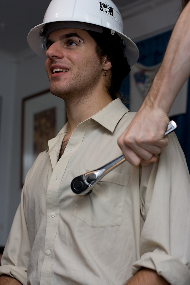 """Alex having his left nipple adjusted by an unidentified male, believed to be using the alias """"Xavier."""""""