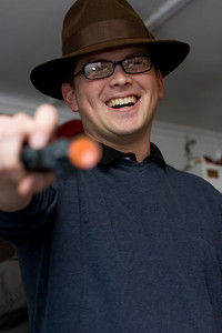 Ed as a gangster with Alex's suction cup gun.  Look, he even holds it sideways like a real gangster!