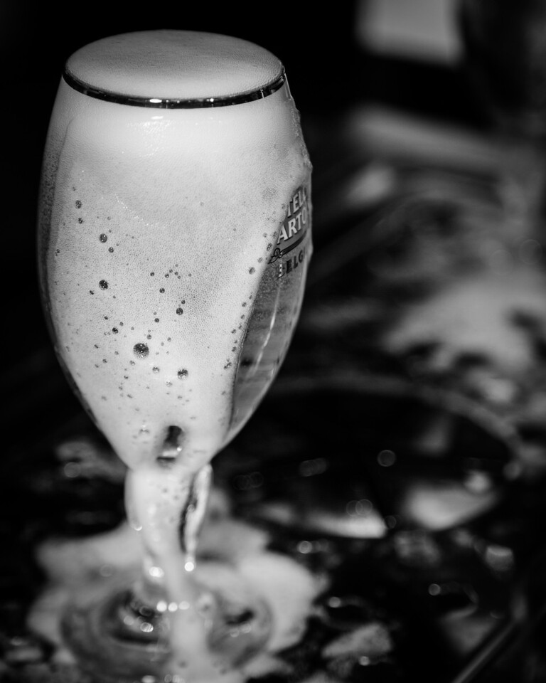 Unlike most pours, the glass is filled over the top to make sure that there is about 1 inch of head on the beer.