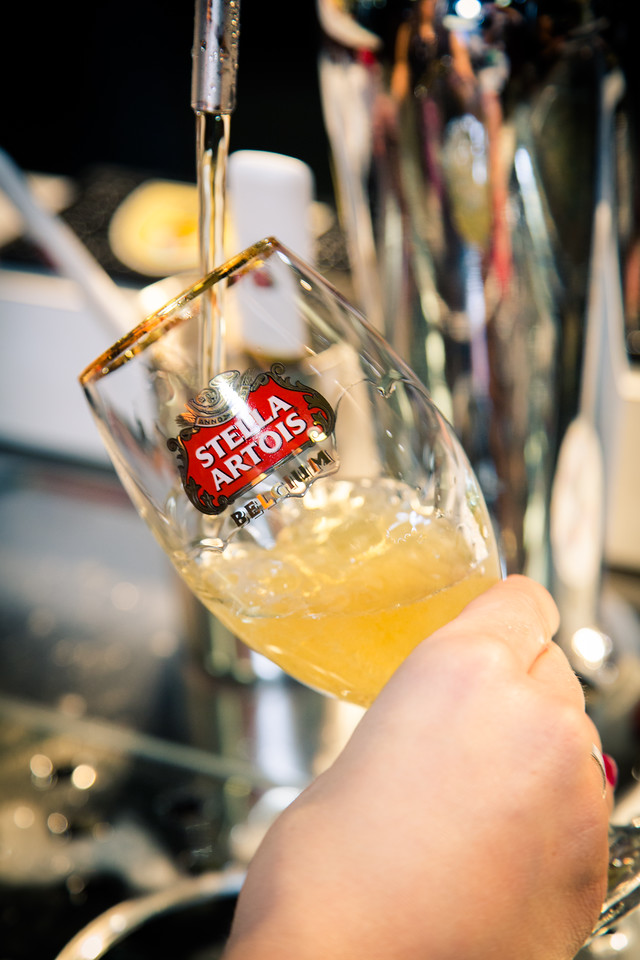 A common practice among bartenders is to place the tap into the glass and often submerge the nozzle into the beer as it pours so as to prevent it from forming a head.  This is not a best practice, as nozzles get covered in old beer which is then rinsed out into your glass. That's an ew in my book.