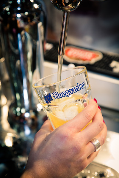 Hoegaarden unlike most beers, is unfiltered.  This means that particulates from the brewing process like barley, hops and yeast are not filtered out, giving it a cloudy appearance.