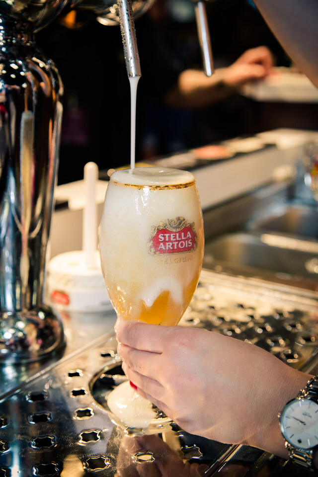 We want to go a little bit passed the point of overflowing.  This is so we can get the beer at the right fill level in the glass while also achieving an ideal amount of foam on top.