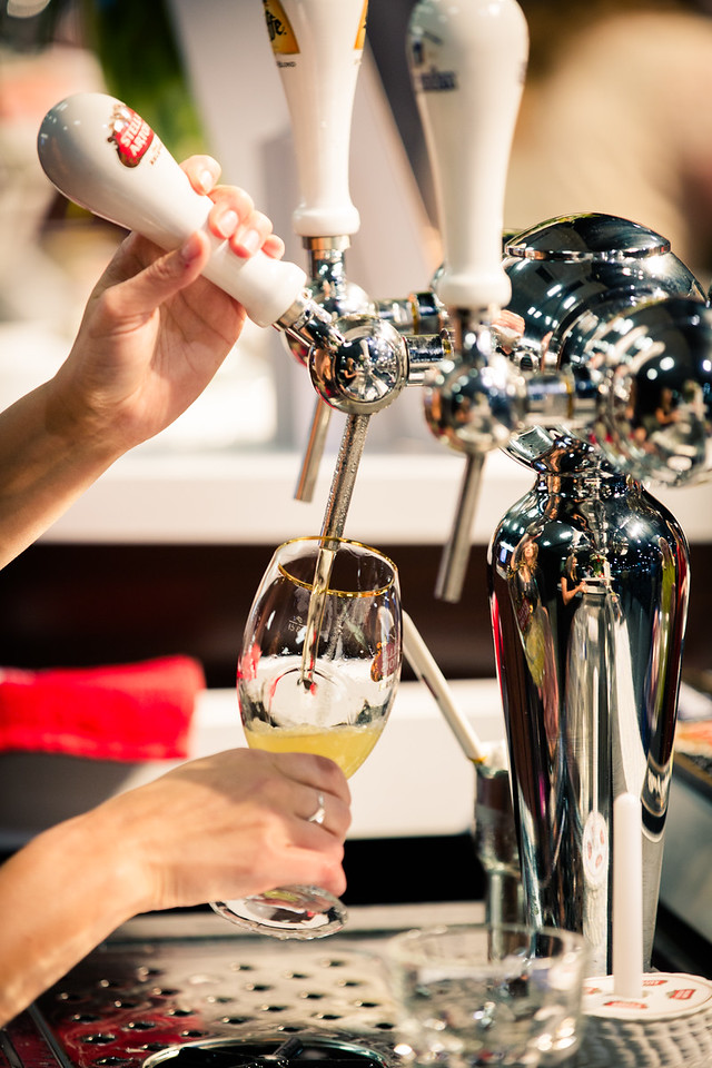 Stella Artois only uses special tap nozzles.  The nozzle never enters the glass and beer never touches the nozzle.