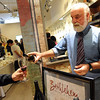 "Bill Musgnung, of Paonia, pours wine for a customer.<br /> Boulder Restaurants and Pearl Street shops teamed up to create the  ""Taste of Pearl,""  a  tasting tour of food at Pearl Street businesses to benefit Emergency Family Assistance Association.<br /> For more photos and a video of the tour, go to  <a href=""http://www.dailycamera.com"">http://www.dailycamera.com</a>.<br /> Cliff Grassmick / April 25, 2010"