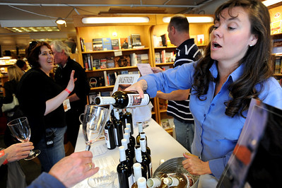 """Julie Balistreri,  of Balistreri Wines, pours a glass in the Boulder Book Store. Boulder Restaurants and Pearl Street shops teamed up to create the  """"Taste of Pearl,""""  a  tasting tour of food at Pearl Street businesses to benefit Emergency Family Assistance Association. For more photos and a video of the tour, go to www.dailycamera.com. Cliff Grassmick / April 25, 2010"""