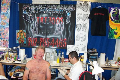 Dave discussing Tattoo with Artist