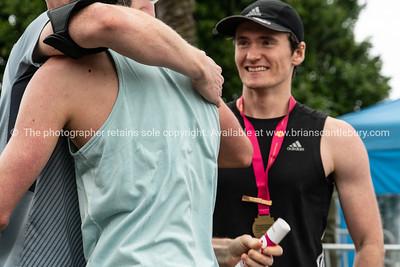 TAURANGA NEW ZEALAND - SEPTEMBER 22 2018;  Embrace after Tauranga International Marathon images around finish line at first running of event. @TaurangaInternationalMarathon