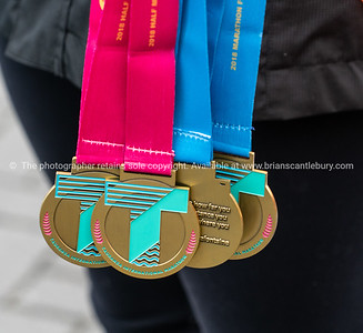 Finishers medals held by official at  Tauranga International Marathon
