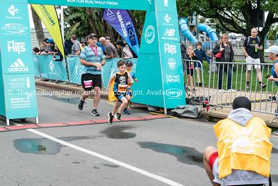 TAURANGA NEW ZEALAND - SEPTEMBER 22 2018;  Finishing in Kids Dash of Tauranga International Marathon images around finish line at first running of event. @TaurangaInternationalMarathon