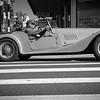 Vintage car parade through city streets