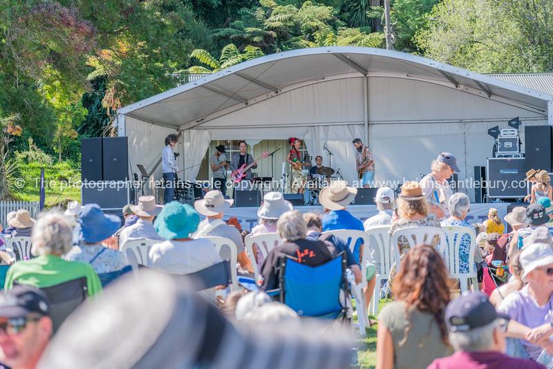 Musicians on stage on village green at Tauranga Historic Village.