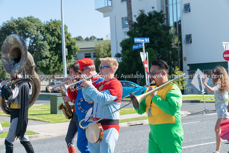 Marching super-heroes playing jazz