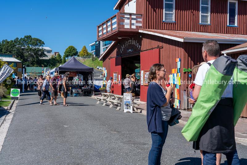 People in Tauranga Historic Village street during 2021 National Jazz Festival.
