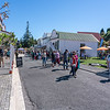 People in Tauranga Historic Village street during 2021 National Jazz Festival.