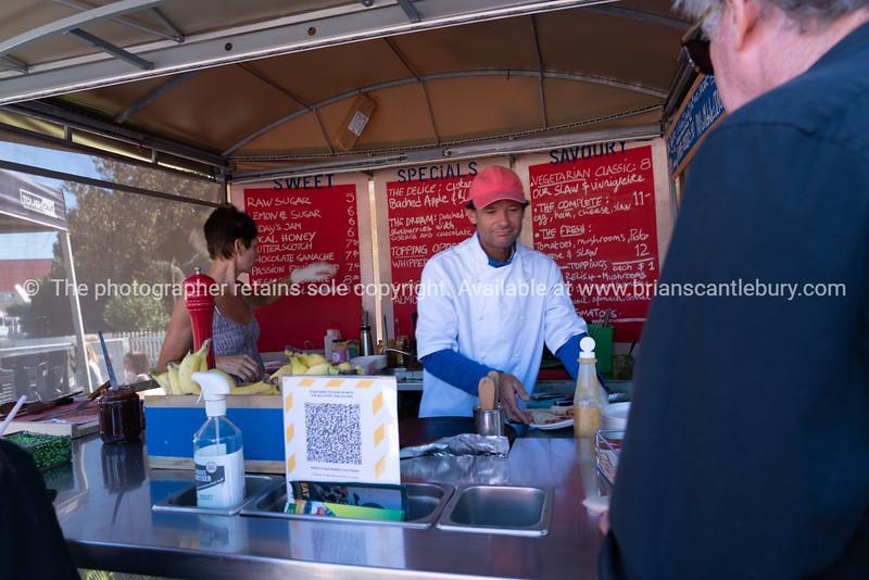 Food vendors at their stall making crepes at Tauranga National Jazz Festival