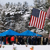 Record-Eagle/Jan-Michael Stump<br /> Shirley Schopieray (cq) of Traverse City watches the funeral of United States Air Force Tech Sgt. Matthew Schwartz Saturday at Memorial Gardens in Traverse City.