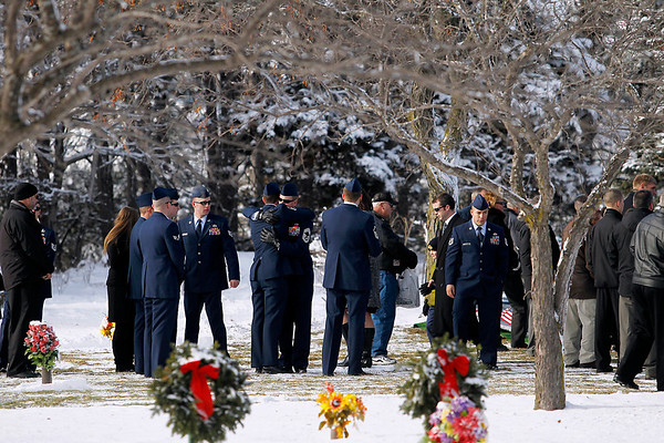 Record-Eagle/Jan-Michael Stump<br /> Mourners leave the funeral of United States Air Force Tech Sgt. Matthew Schwartz Saturday at Grand Traverse Memorial Gardens. Schwartz, 34, of Traverse City died in Afghanistan January 5, 2012, when his vehicle was struck by a improvised explosive device. Several local businesses provided hotel rooms and rental cars so that over a dozen of Schwartz's fellow explosive ordinance disposal team members, assigned to the 90th Civil Engineer Squadron at F.E.Warren Air Force Base in Wyoming, could make the trip.