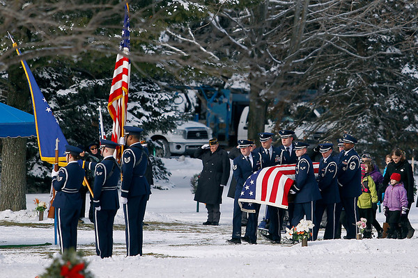 Record-Eagle/Jan-Michael Stump<br /> Pall bearers lead the casket of United States Air Force Tech Sgt. Matthew Schwartz through Grand Traverse Memorial Gardens Cemetery Saturday following funeral services for the 34 year-old Traverse City native, who died in Afghanistan January 5, 2012.