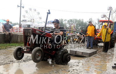 8/27/2011 Mike Orazzi | Staff Alex Mann competes in the garden tractor pull while at the Terryville Country Fair on Saturday morning.