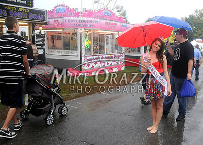 8/27/2011 Mike Orazzi | Staff Miss Bristol's Outstanding Teen Jenna Kowalec attempts to stay dry while at the Terryville Country Fair on Saturday morning.