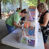 Family members entered special raffles to get a chance to win a prize at the Tewksbury-Wilmington and Woburn Elks Clubs  combined Family Day picnic. Photo by Mary Leach