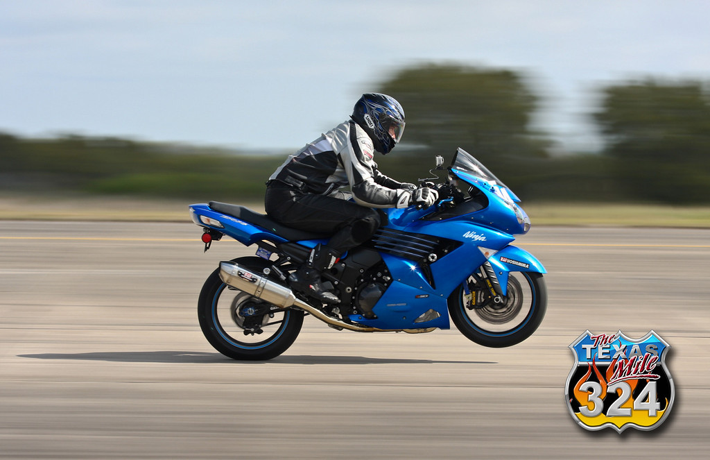 Mark Vickers rides a wheelie through the start of his Mile pass.<br /> March 2011<br /> (From the March 2010 event)