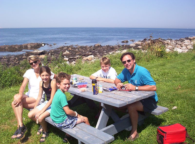 A family from Essex enjoys an afternoon picnic on Thacher Island.