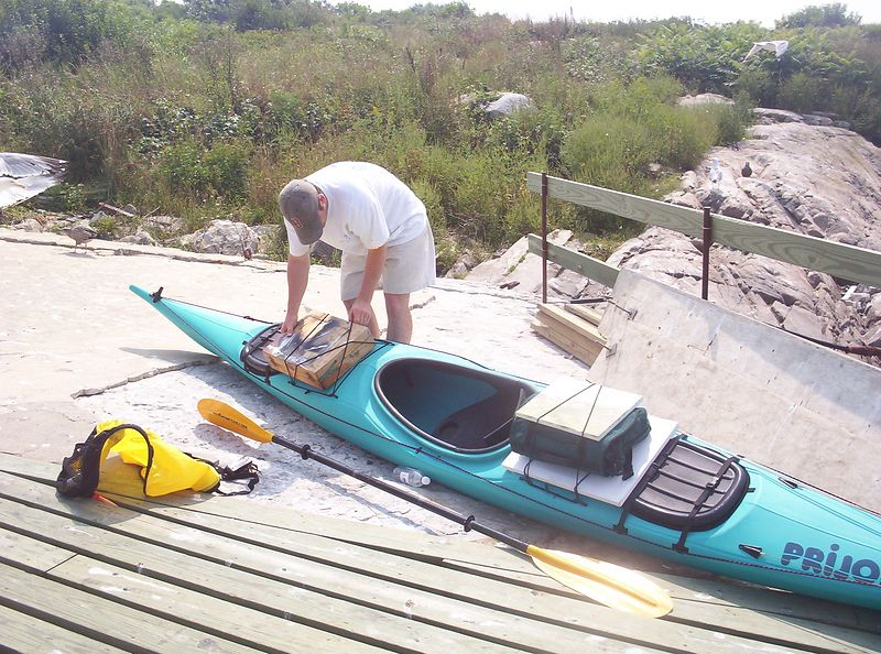 Packing up the artist's tools to kayak back to shore