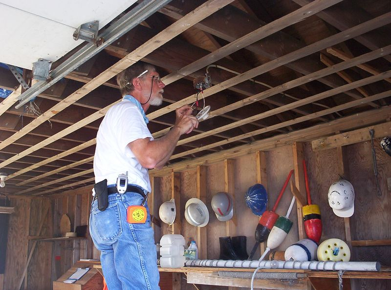 Keeper #1 busy in the Boat House fixing a light.