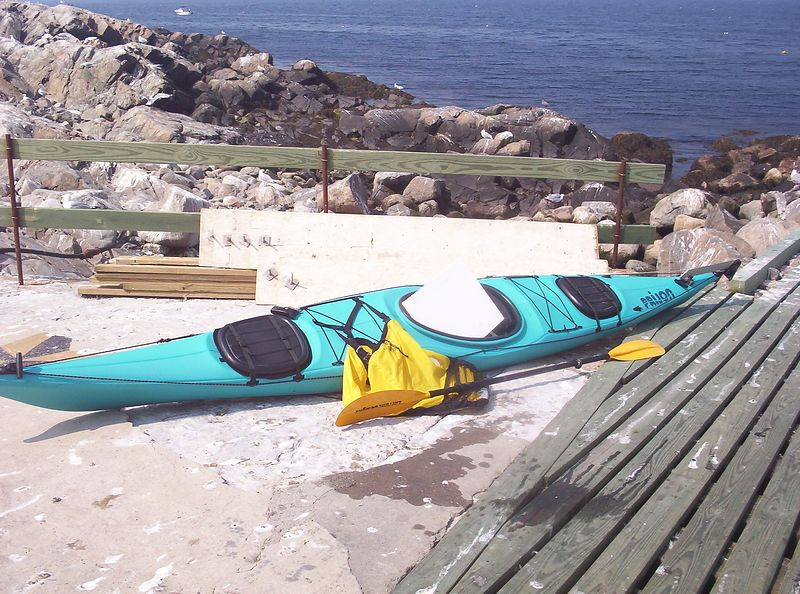 An artist comes by kayak to the Island.